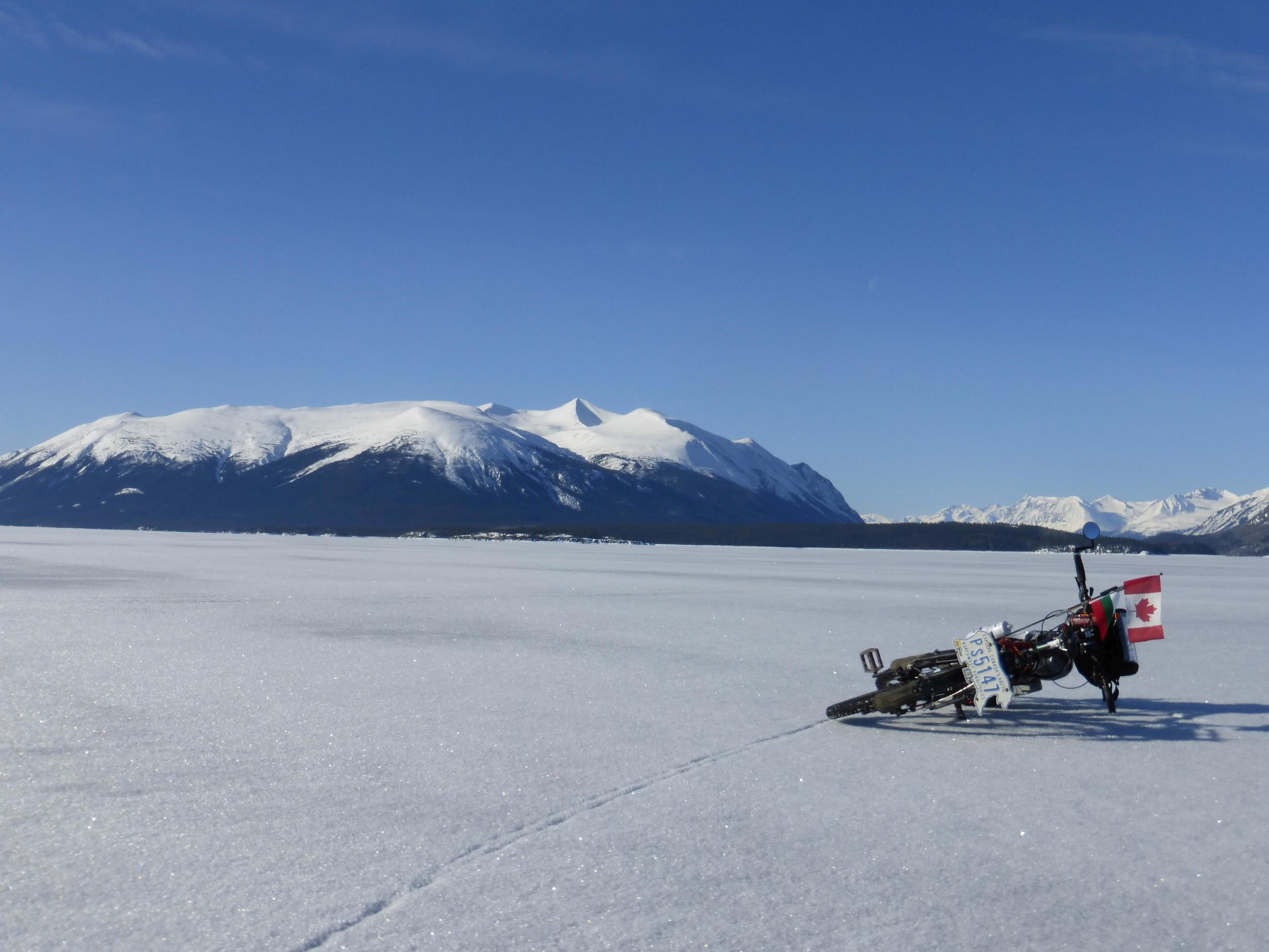 (Mount Theresa). Atlin lake is the biggest freshwater lake in British Columbia. Riding on the snow covered ice isn't exactly easy but 75km seems doable. I only have a little bit of water and Oreos for food.