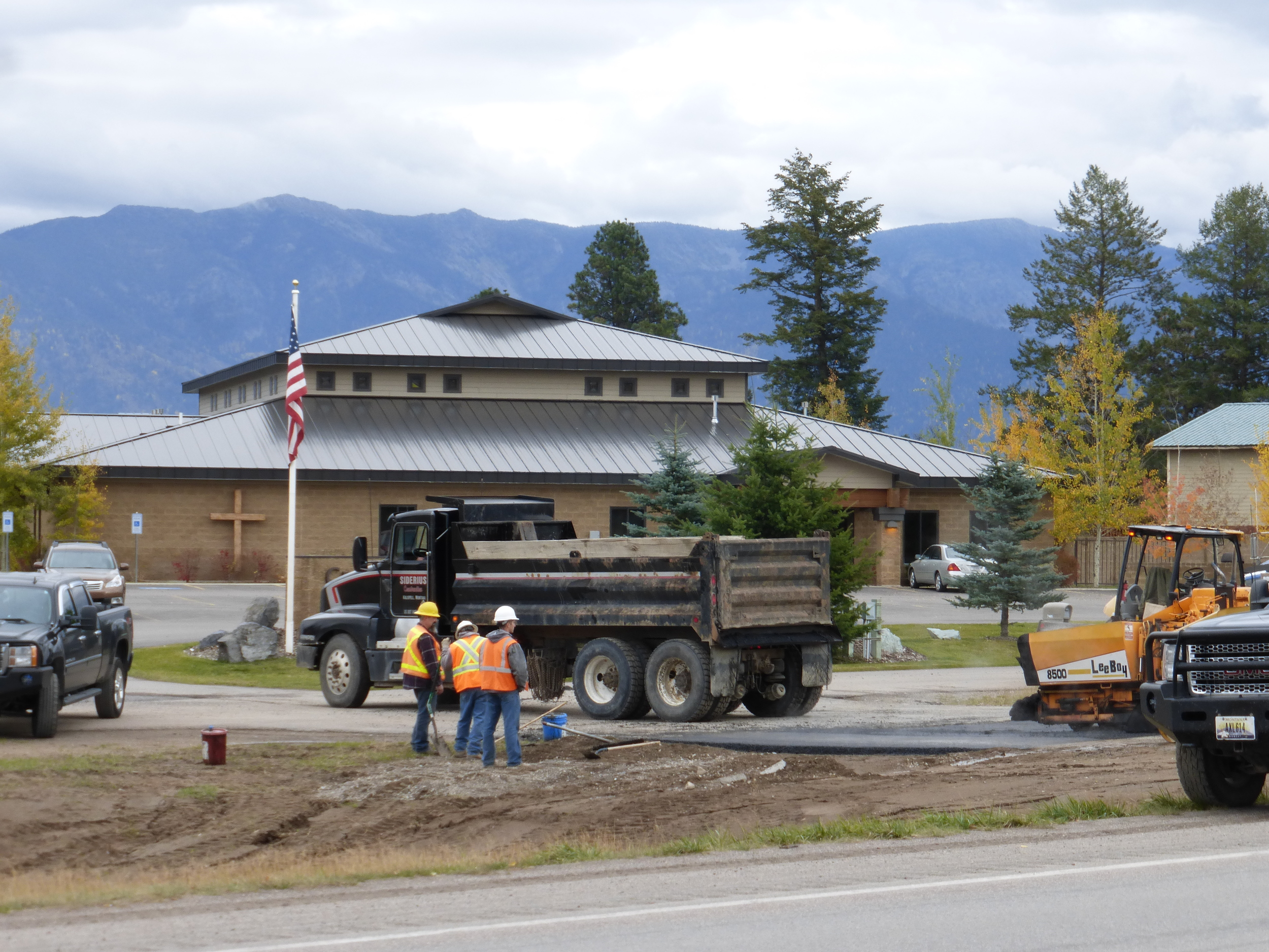 Montana DOT putting taxpayer money to good use, AKA how many people does it take to pave a driveway (there are 2 more on the other side out of view)