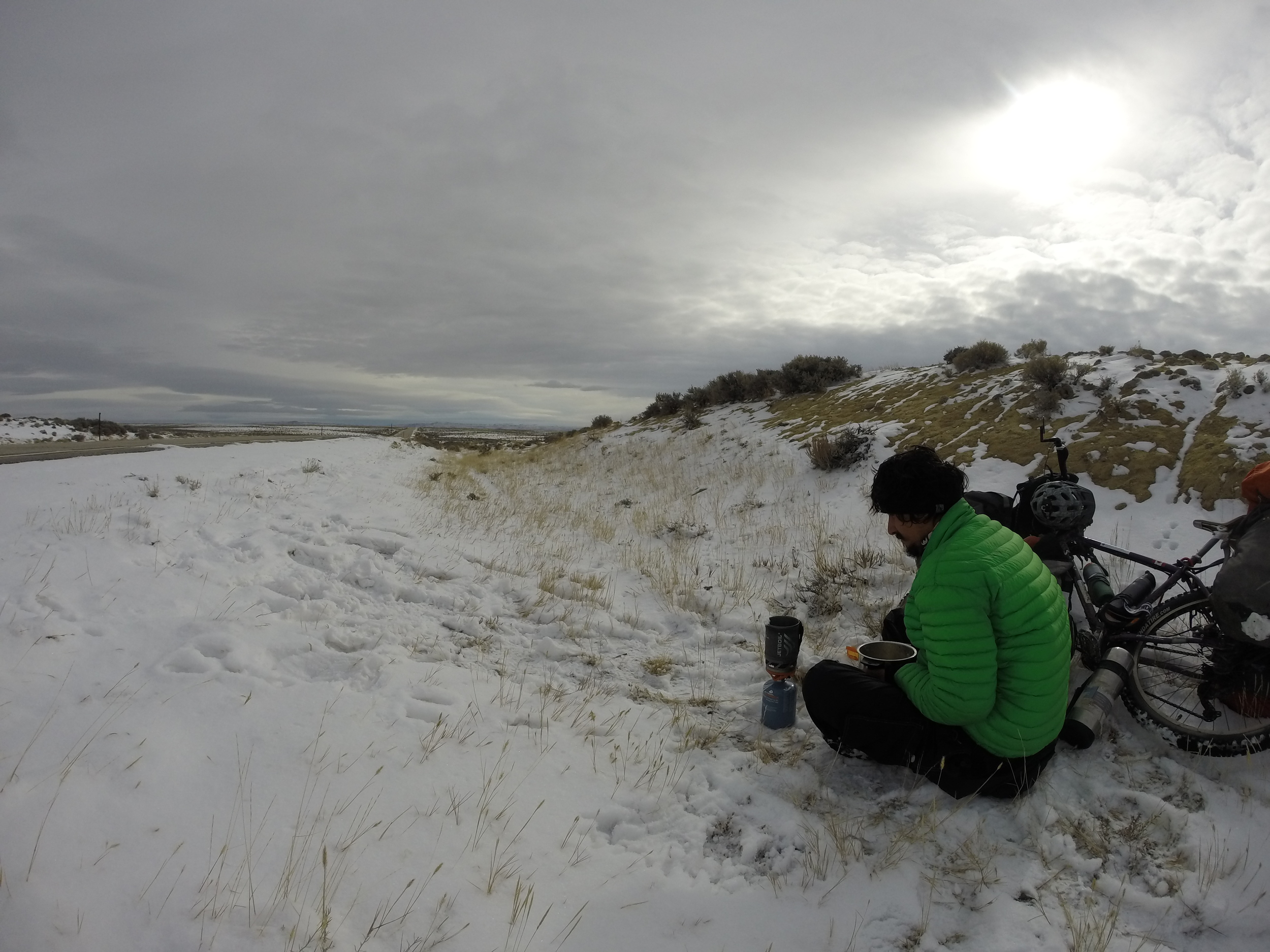 The ditch was the only place offering some cover from the wind. I stopped to melt snow for lunch & drinking water.