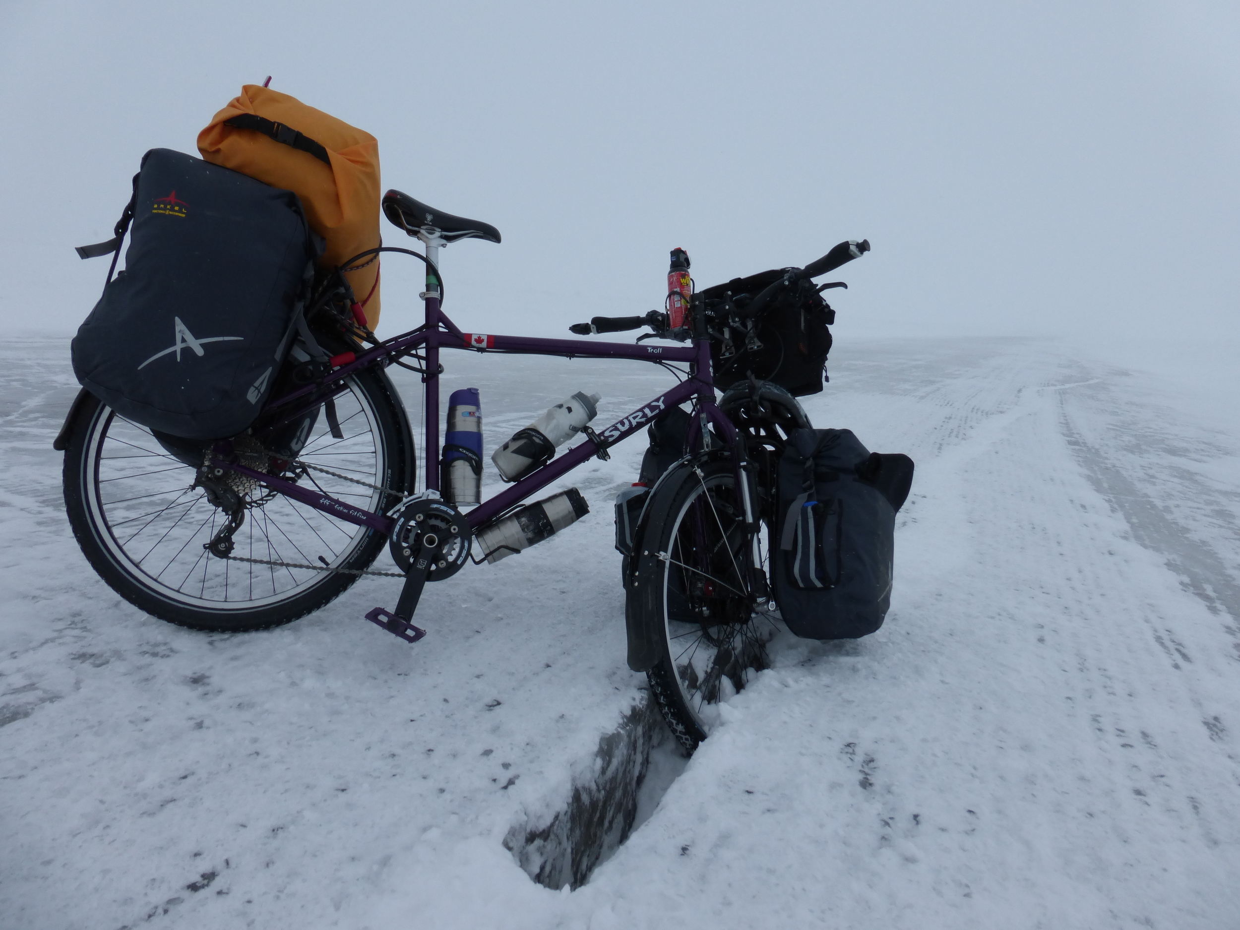 One of the biggest challenges was the ice road - at -20C 2 cracks ran along the road zig-zagging and I had to constantly cross them. I fell over 30 times in the two days I was there (landing on the overloaded panniers most of the time)