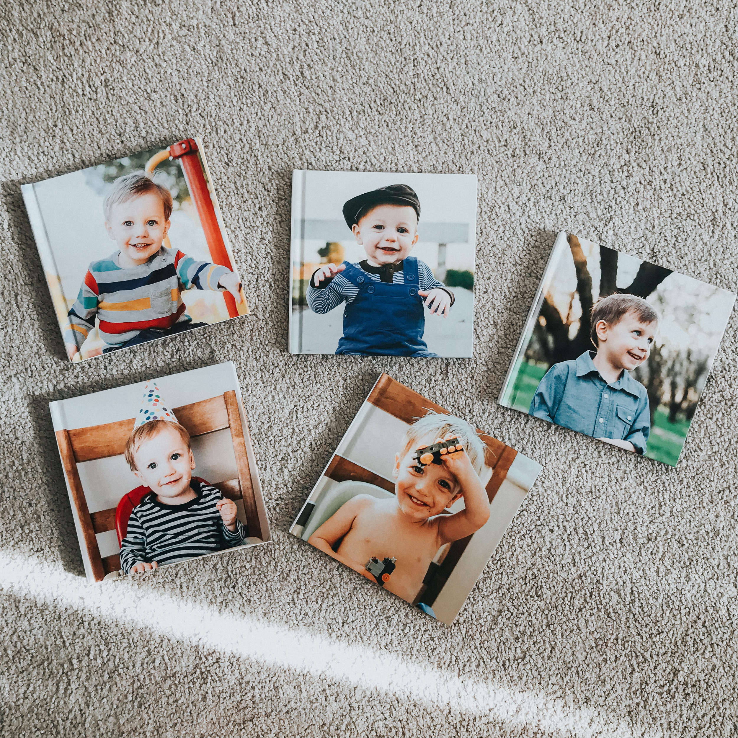 All my Blurb birthday books - I design these in Lightroom and love how they turn out. I've given these as grandparent gifts and they've always been a big hit.