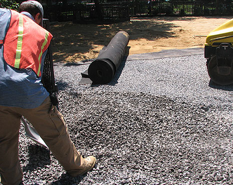 Close up of the materials that create the running field for the Tompkins Square dog run. The gray rock goes below grade for drainage, the brown mix in the background forms the smooth, paw-friendly running surface