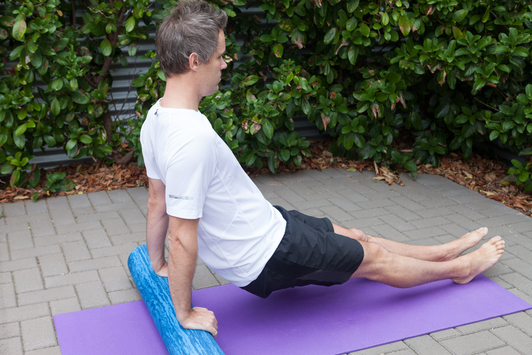 Tricep Dips   Use the foam roller to bring some more intensity to the tricep dip.  This exercise will help develop resilience in the shoulder stabilisers.  Take care not to do too much too soon.