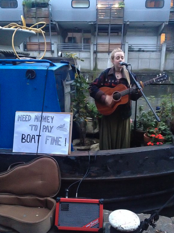 Ny Oh and her boatmates got fined for mooring illegally. They payed the whole fine by busking