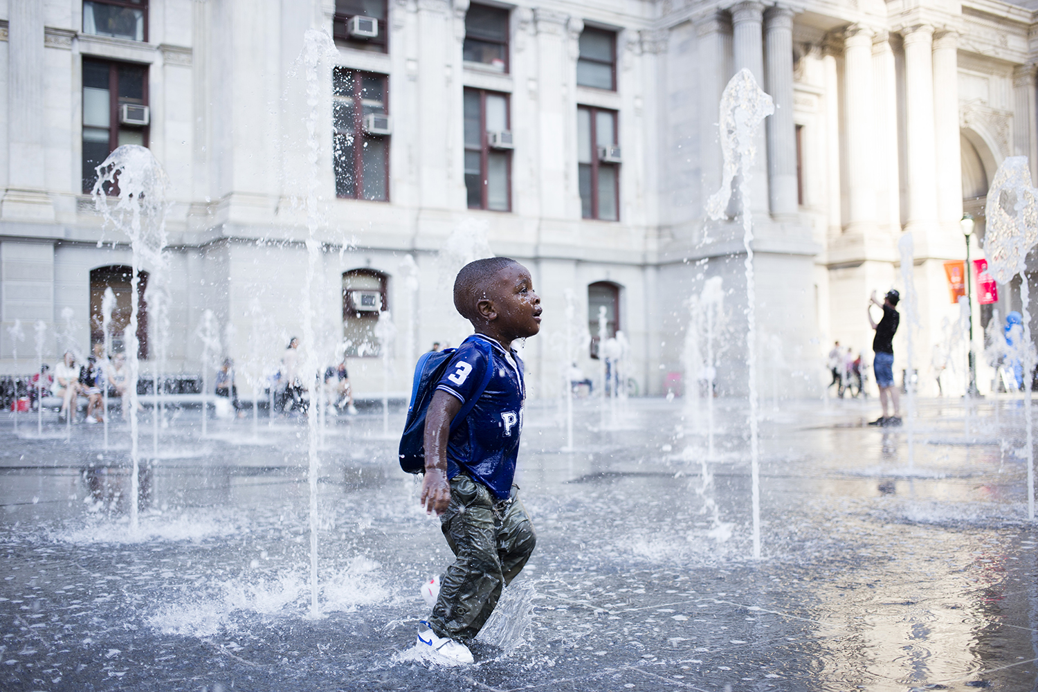 A young boy plays in a recycled-rainwater fountain at the newly unveiled Dilworth Park, which officially opened to the public on Sept. 4.