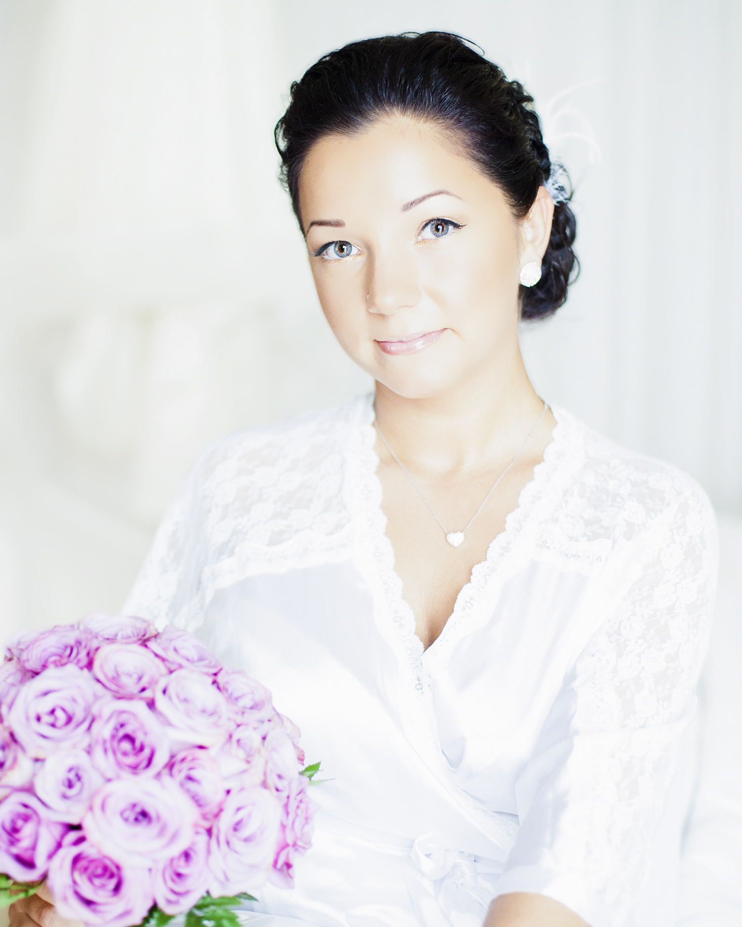 Portrait of a bride with a bouquet or roses