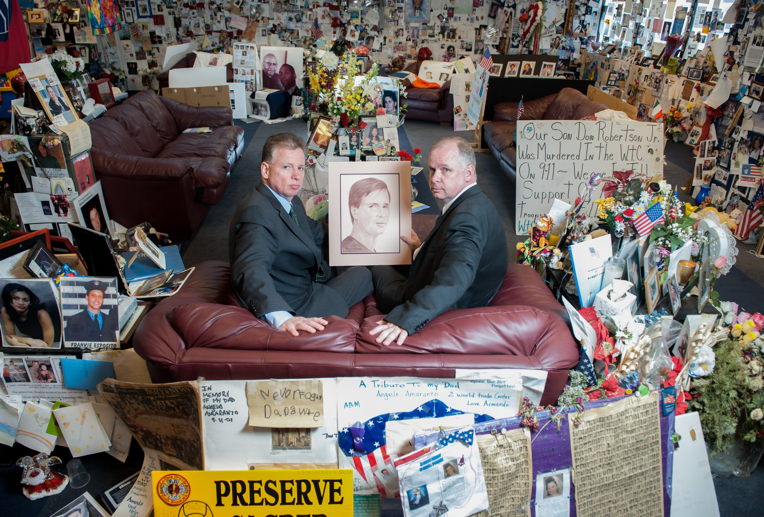 Tom and John Owens hold a sketch of their brother, Pete, in the One Liberty Plaza Family Room overlooking the World Trade Center site. The room provides a privatecontemplation areafor families of the victims as they approach the tenth anniversary of the 9/11 attacks.