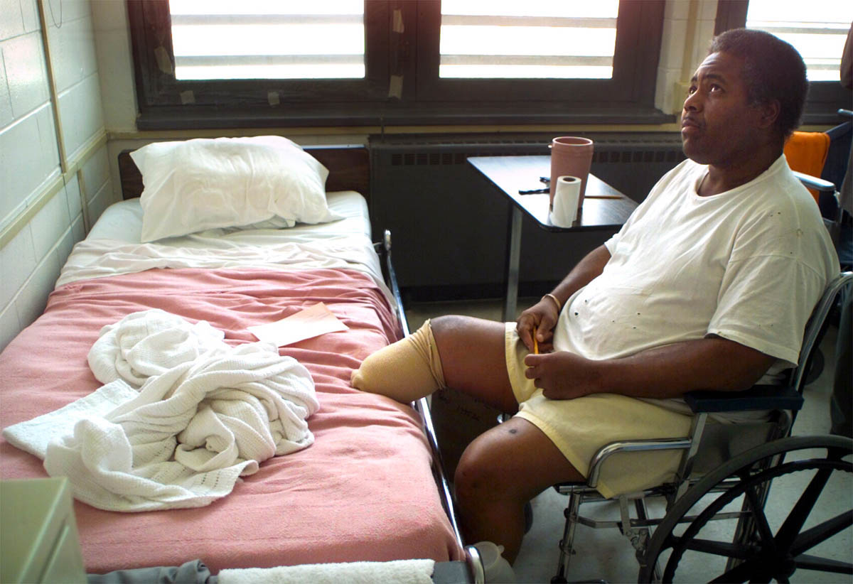An inmate who lost his leg to an untreated infection spends his days watching TV in the prison infirmary.