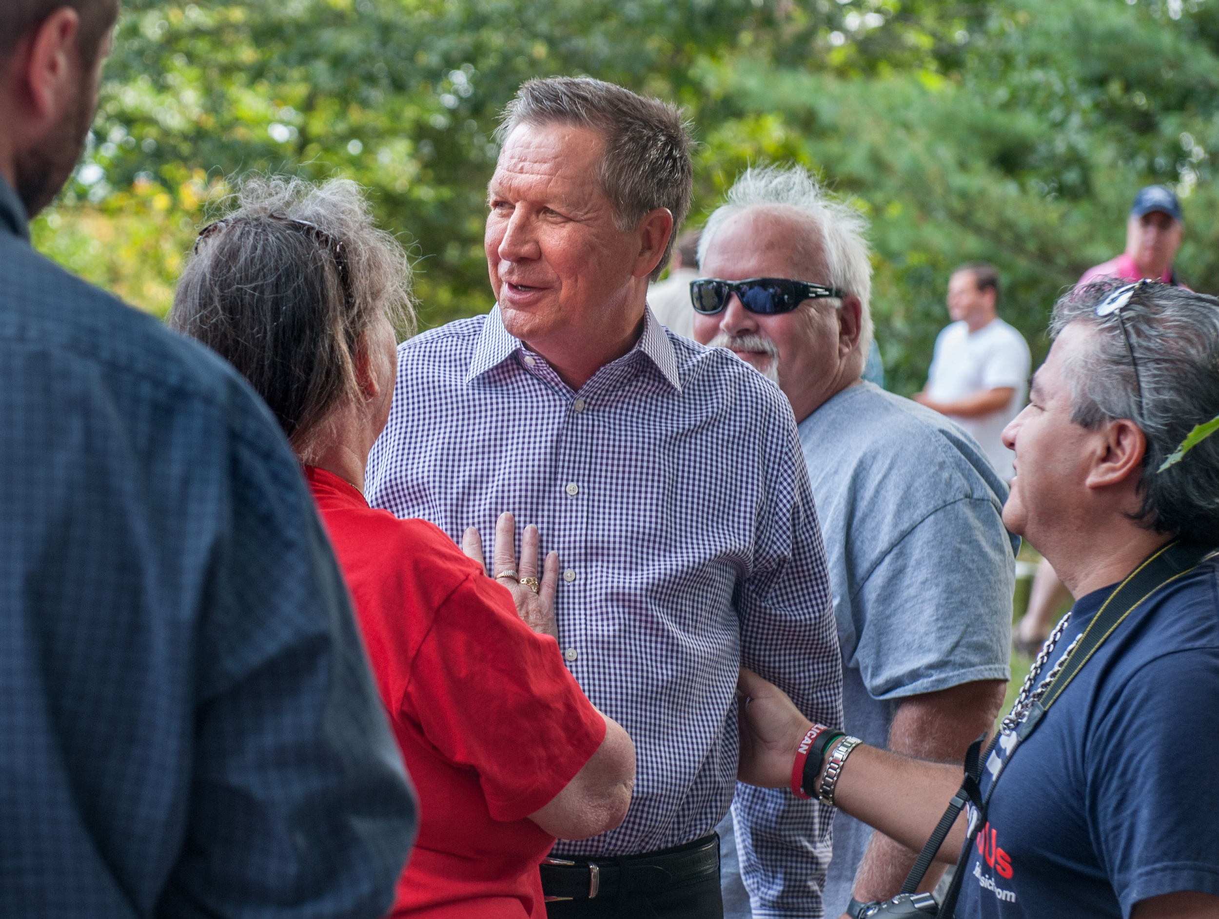 Visitors to the Stafford County GOP BBQ and Beer bash get up close with Ohio Governor John Kasich in Dover, New Hampshire Saturday. Kasich has shown steady poll numbers of around 9 percent in the GOP primary race the Granite State.
