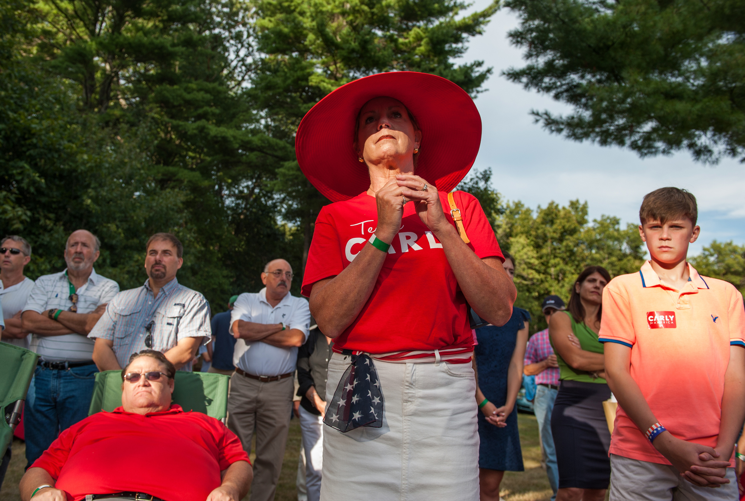Donna Marie Everett, a Carly Fiorina supporter from Dover, watchers her candidate speak at the Stafford County GOP BBQ and Beer bash in Dover, New Hampshire Saturday, September 12, 2015. Everett says if her candidate does not win in the crowded field she would be a great cabinet member for a potential next Republican President.
