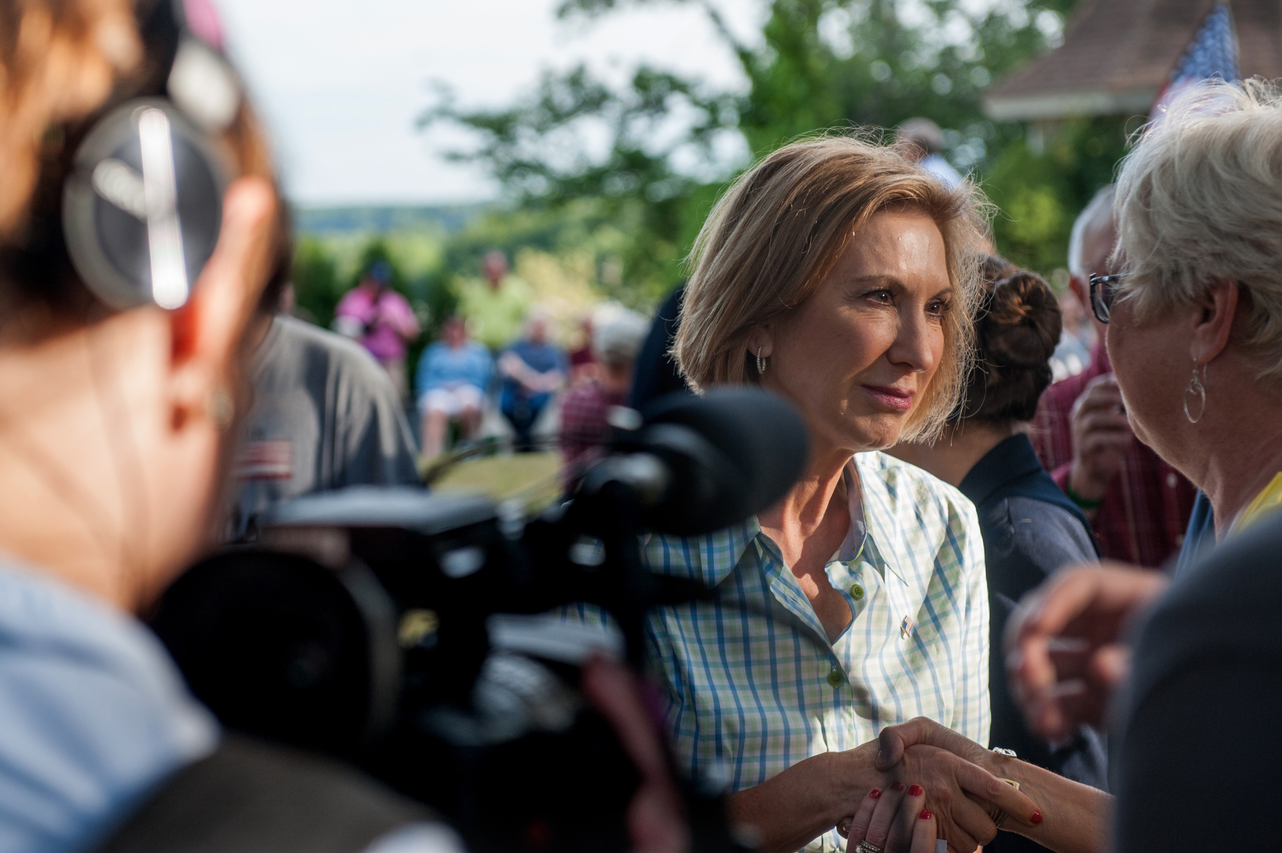 Media and GOP voters in New Hampshire showed renewed attention to presidential candidate Carly Fiorina whose poll numbers and crowds are up after personal attacks from frontrunner Donald Trump.