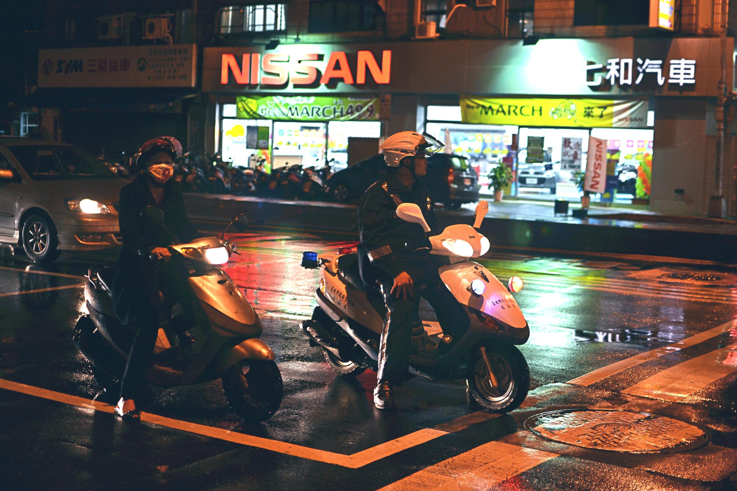 Mopeds at night in Taipei, Taiwan