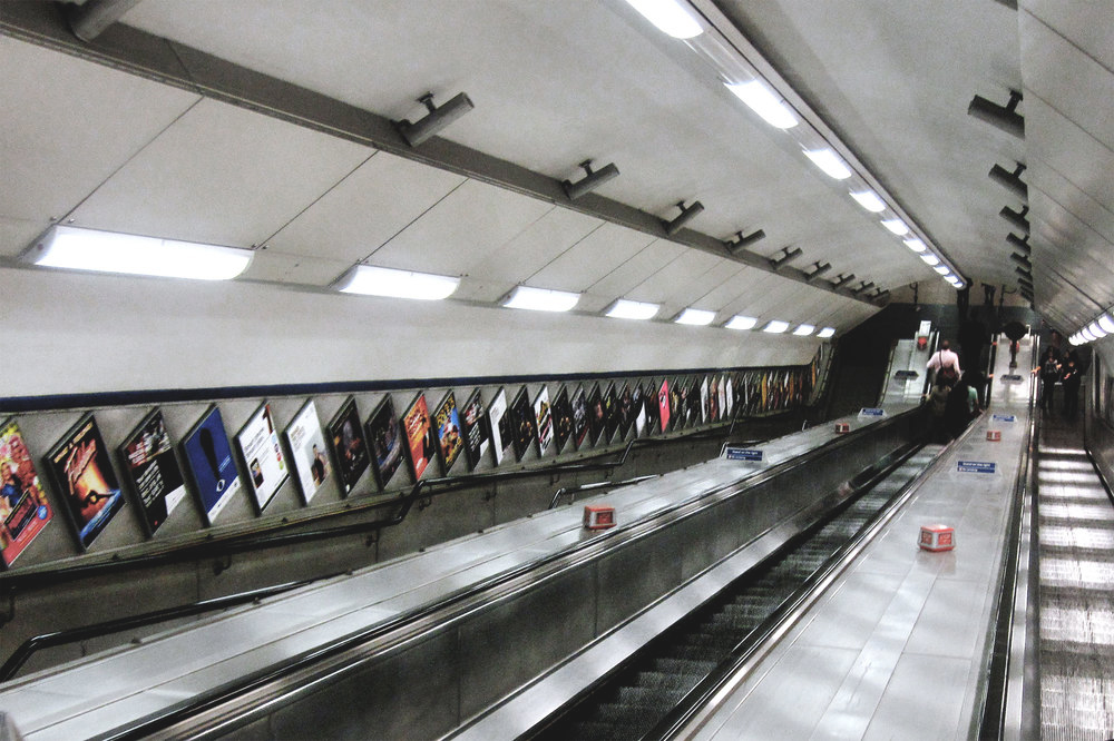 An escalator down to The Tube in London