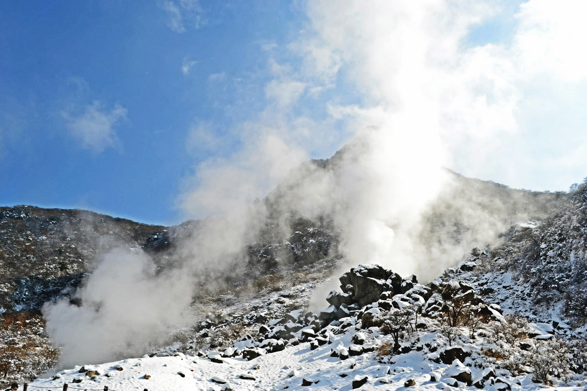 Natural steam rises from the mountains of Owakudani