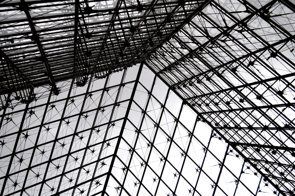 Looking up at the pyramid from inside The Louvre