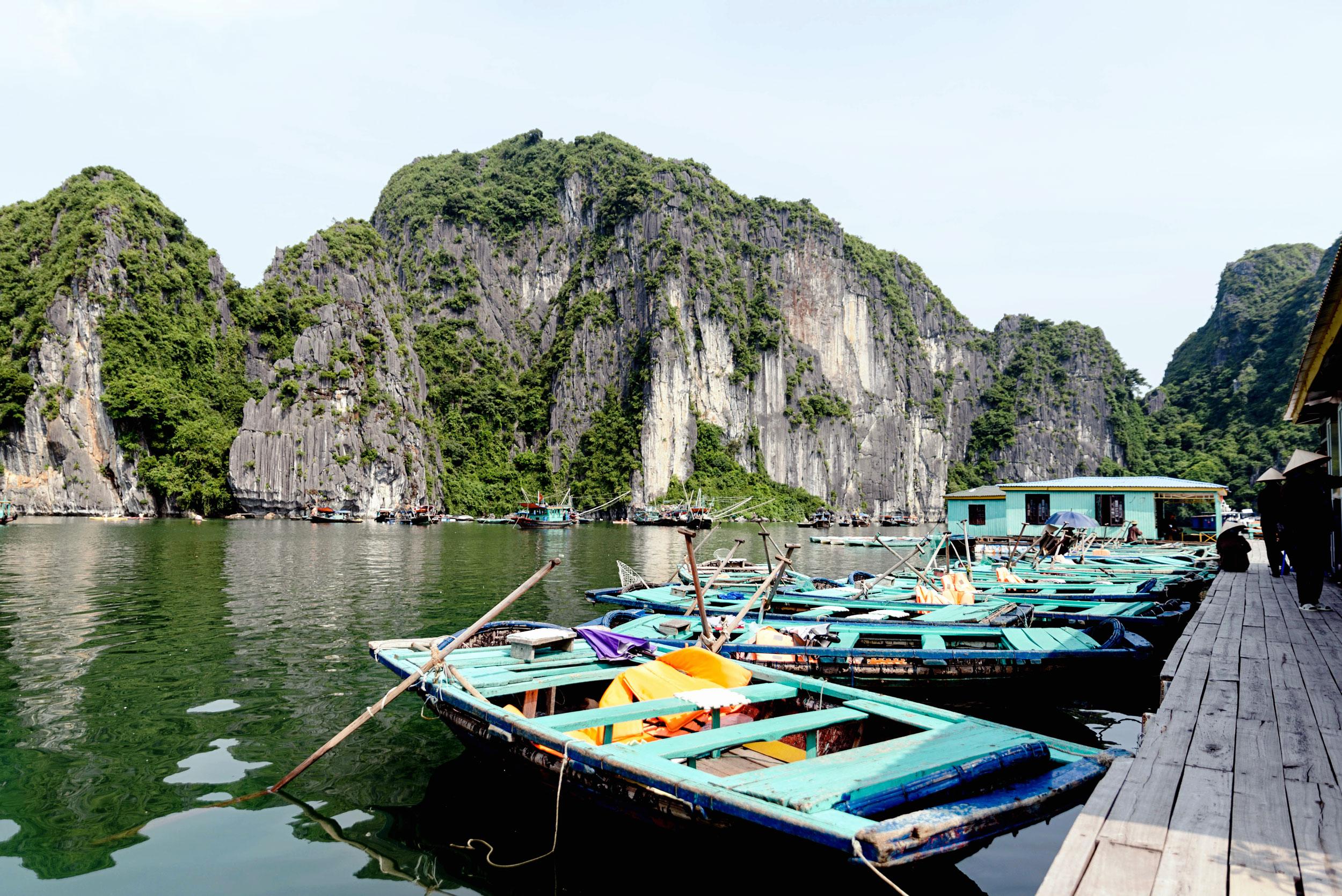 Row boats to explore Ha Long Bay