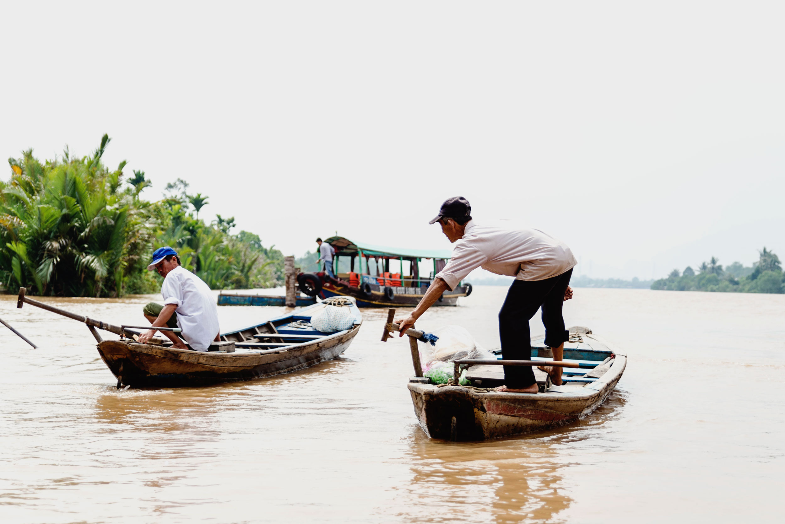 Locals on a boat on the Mekong river in Vietnam