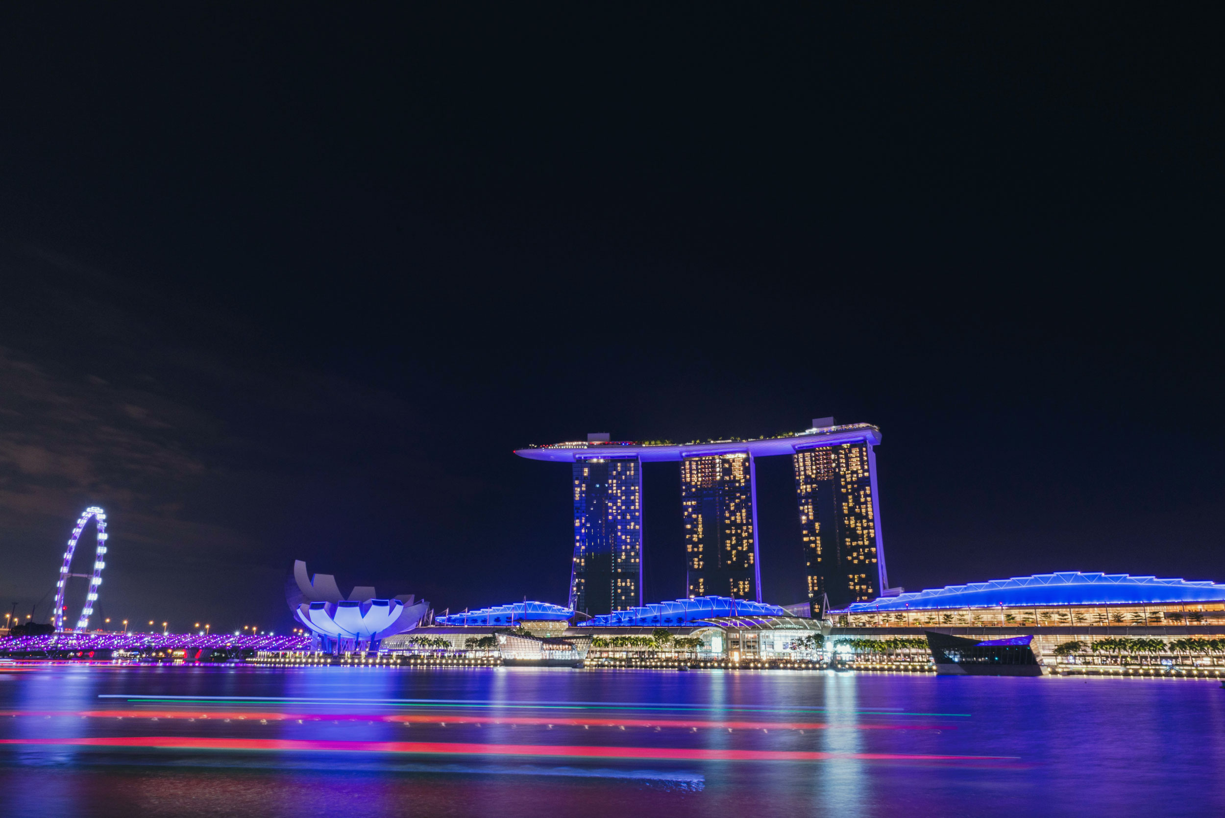 A boat streaks by the Marina Bay Sands in Singapore