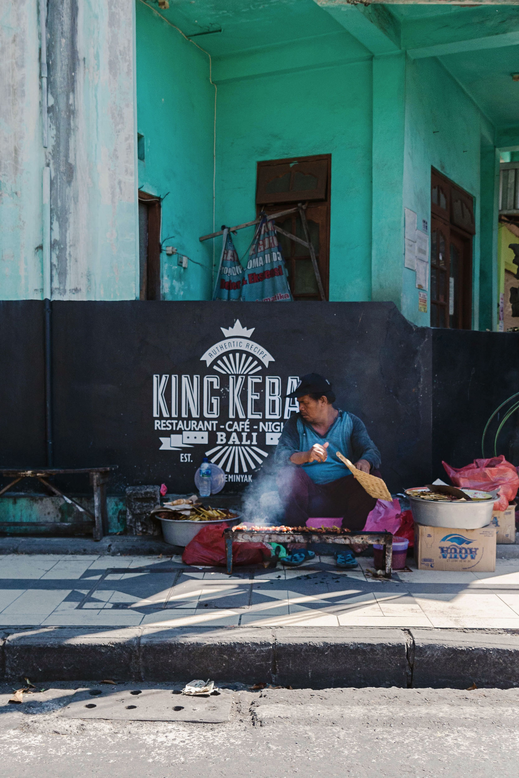 A man grilling on the street in Bali