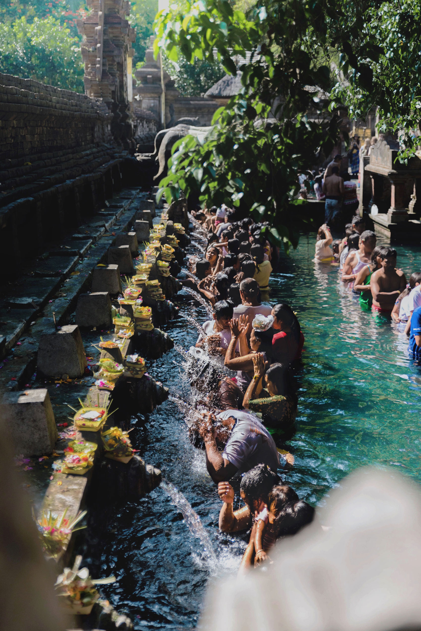 People bathing at the Tirta Empul water temple in Bali