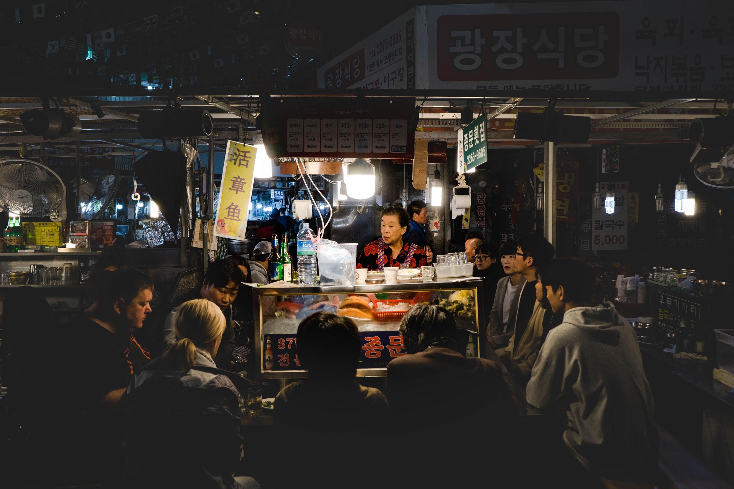 "A food stall at Gwangjang market in Seoul that serves san-nakji or ""live"" octopus."