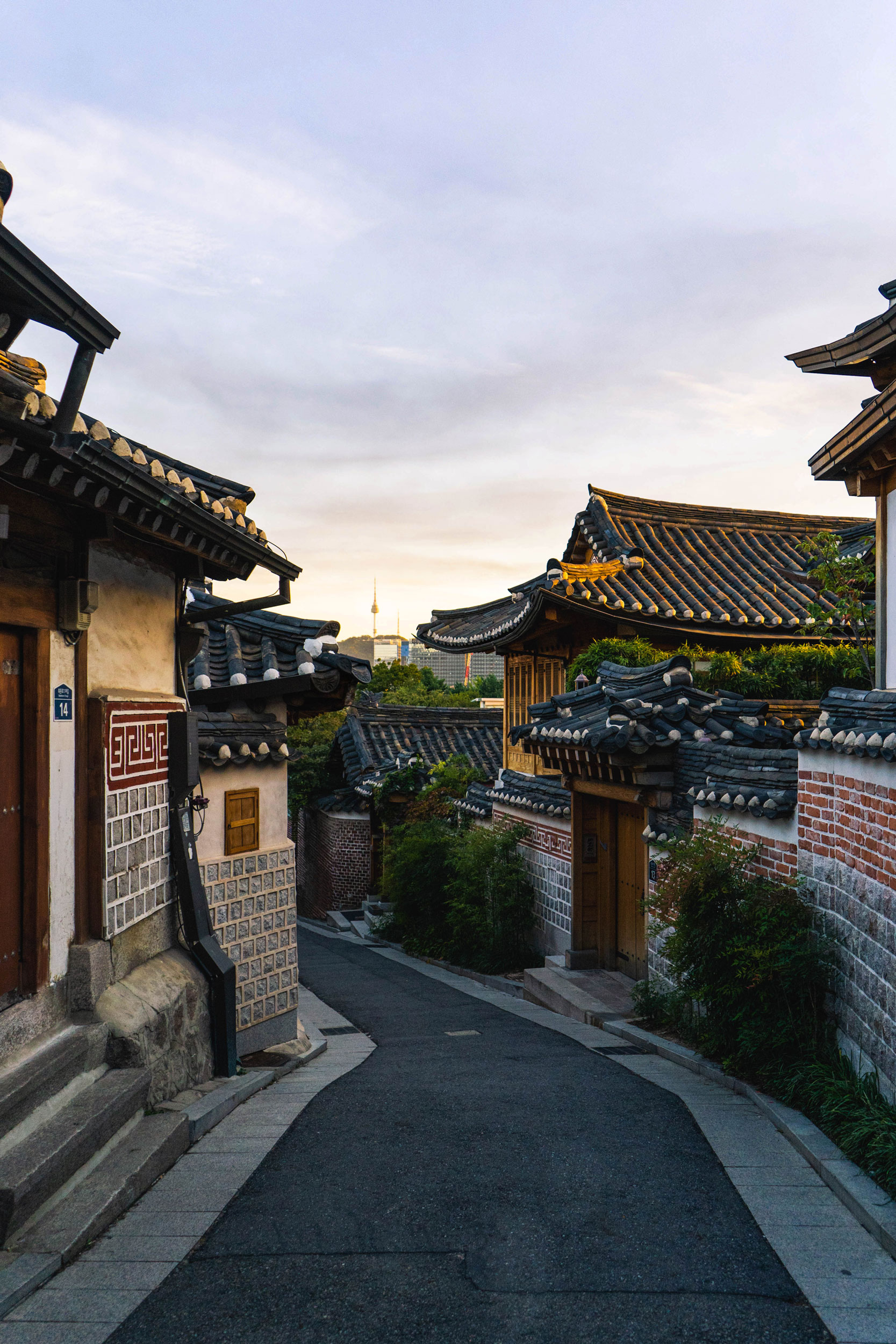 Bukchon Hanok Village in the late afternoon with Seoul Tower in the background