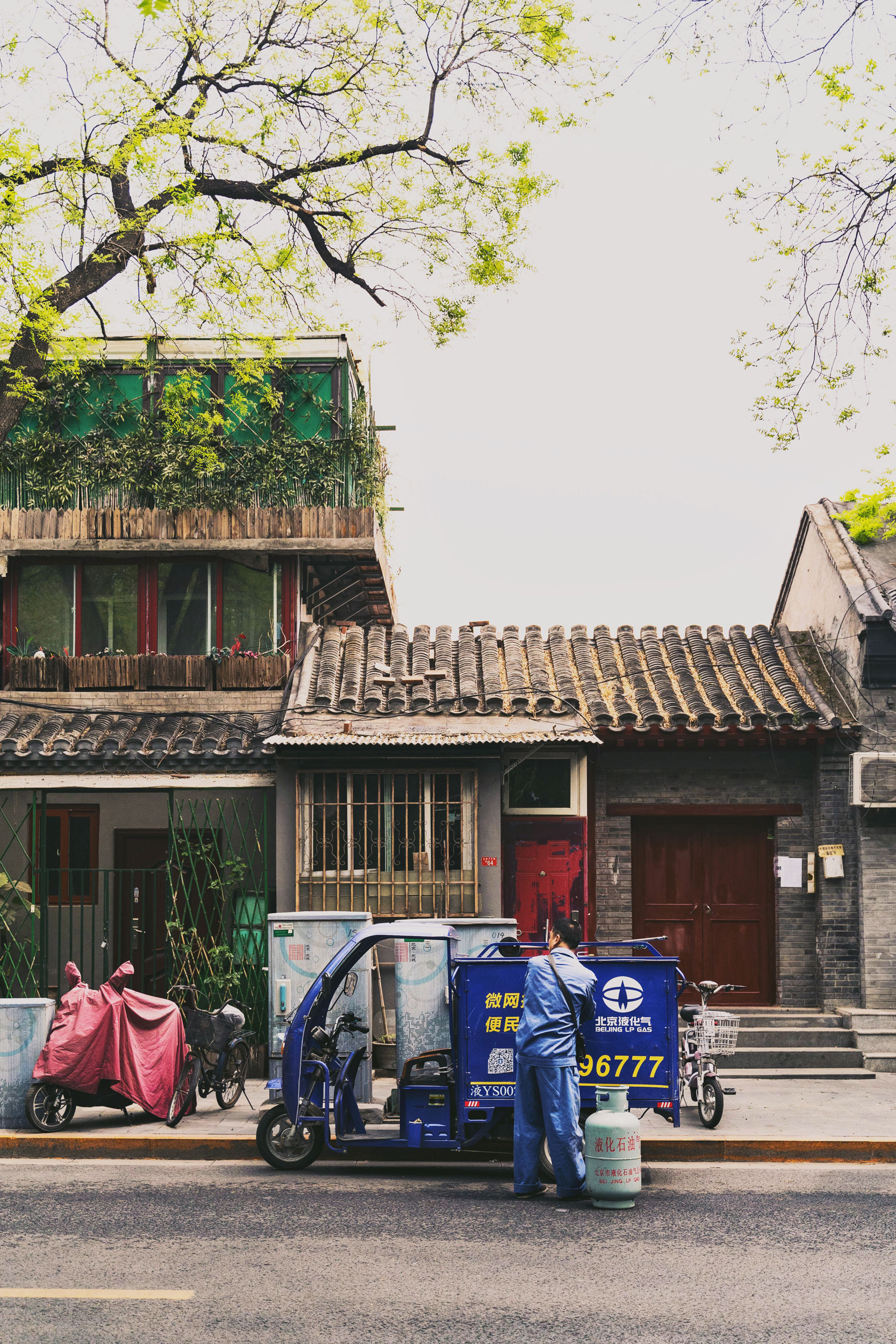 Gas delivery to a home in Beijing's Donghuamen residential district.