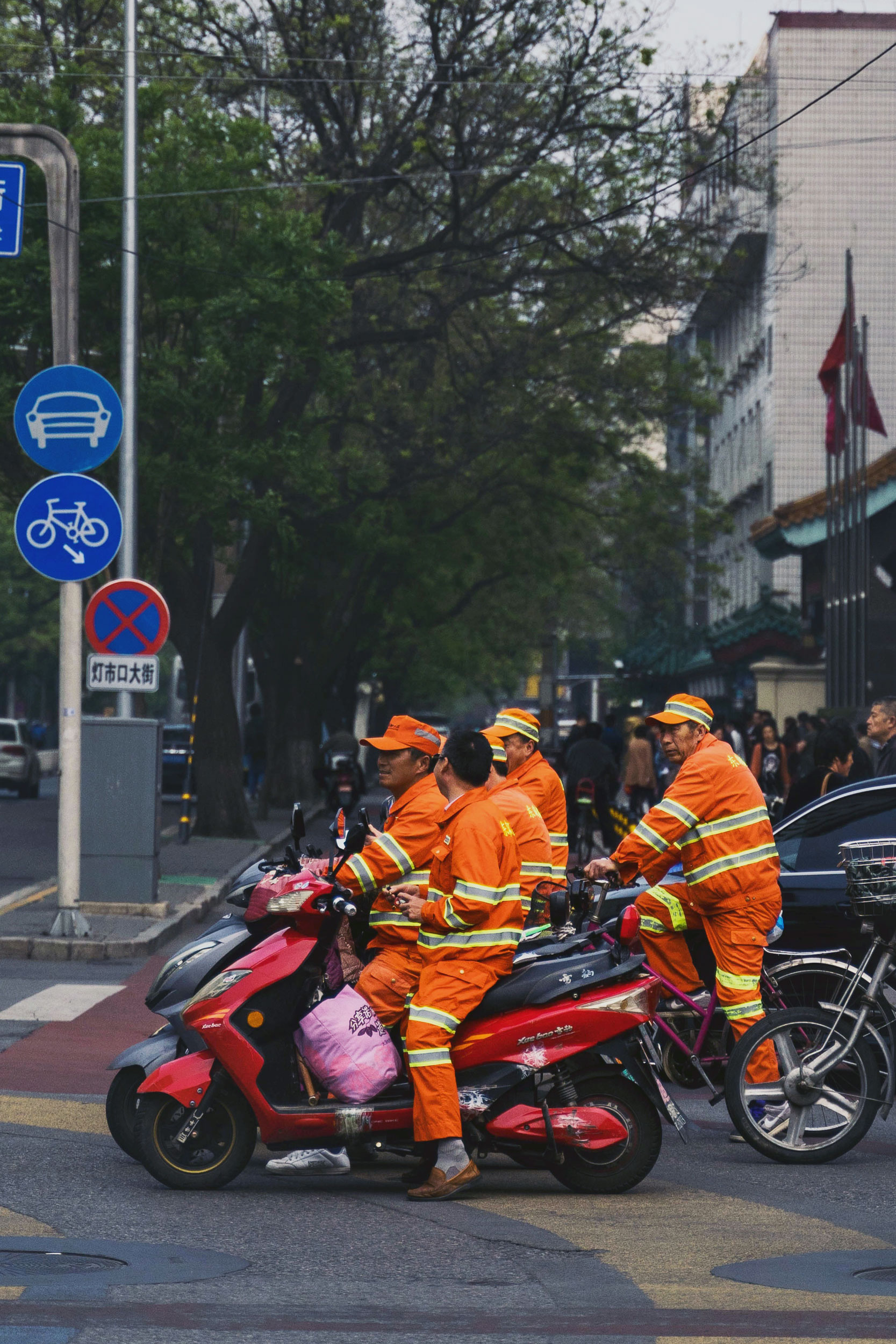 Some workers stop at a traffic light on the way home.