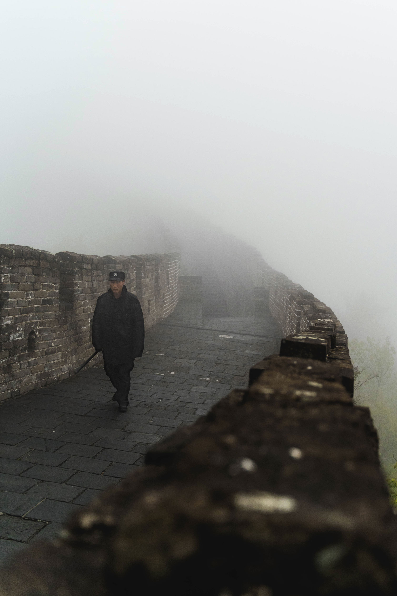 A man walks the Great Wall on a foggy, early morning. [  INSTAGRAM  ]