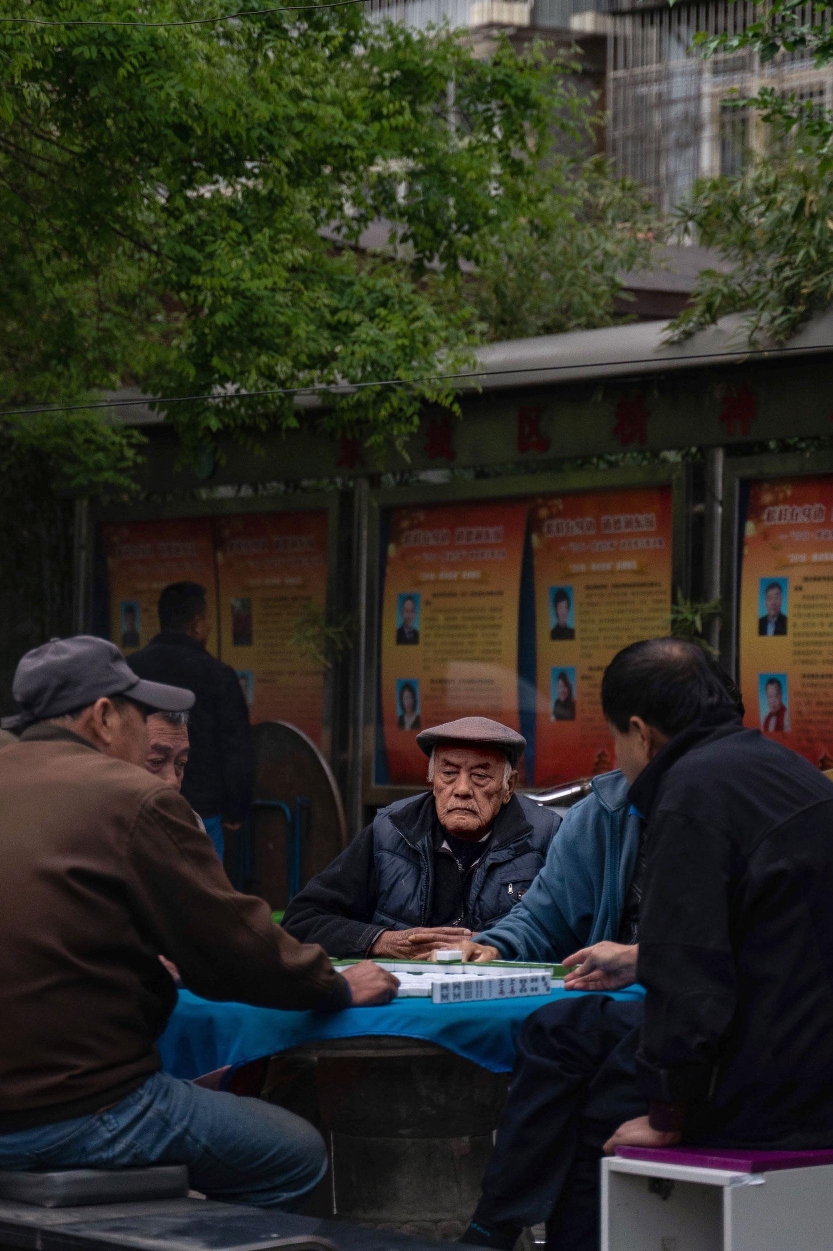 A serious group playing Mahjong near Dafangjia Hutong.