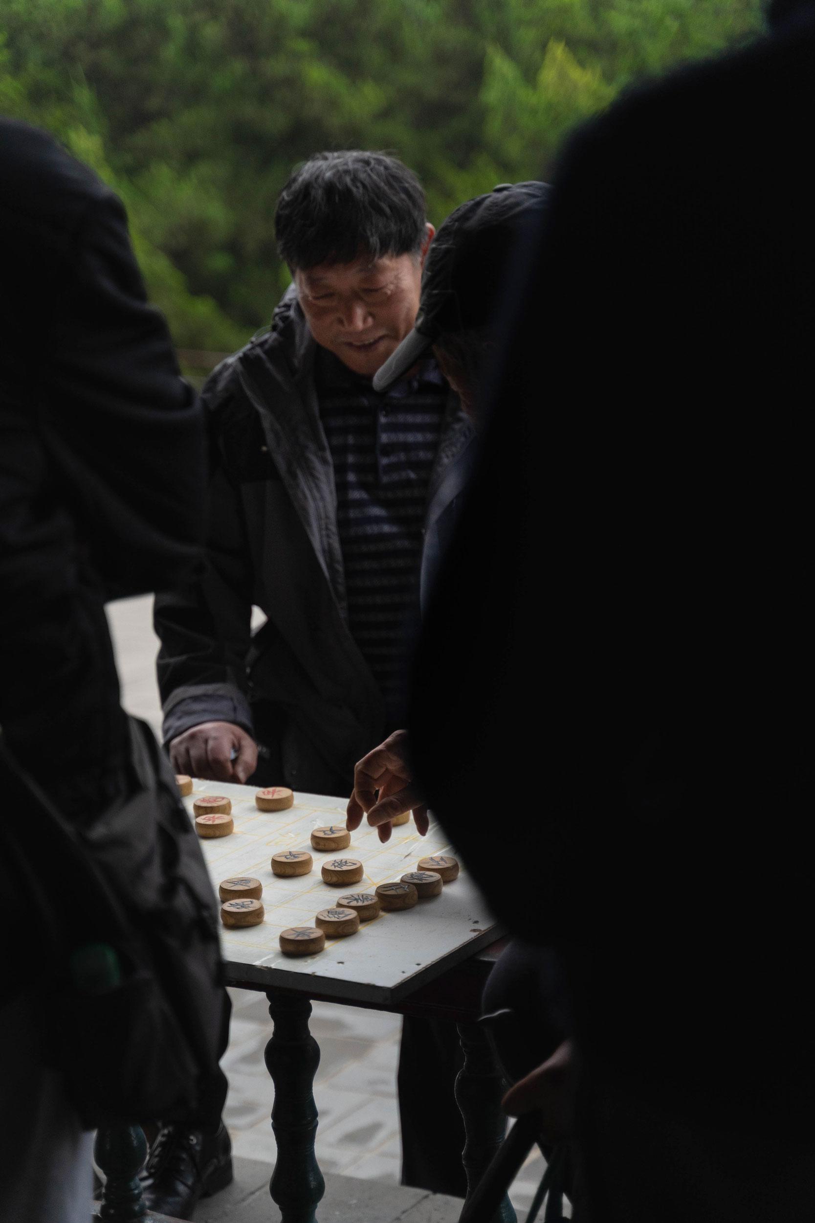 Men playing Xiangqi (Chinese chess) near the Temple of Heaven.
