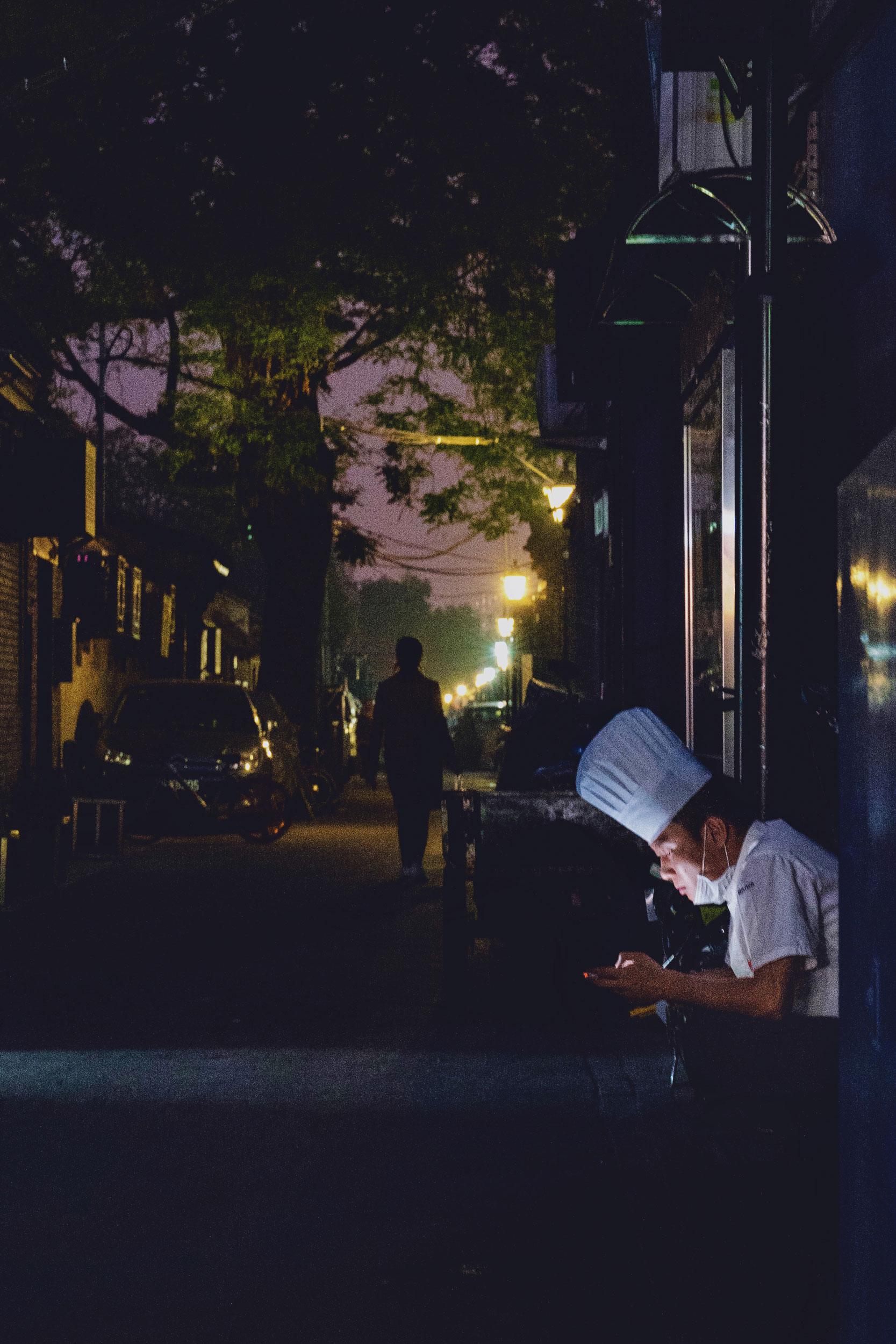 A worker goes on break at Luogu Lane.