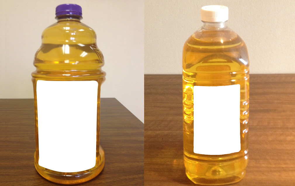 Which of these bottles is juice and which is Tiki torch fuel? You might be able to tell, but can your kids? (Photos from  UAB Youth Safety Lab .)