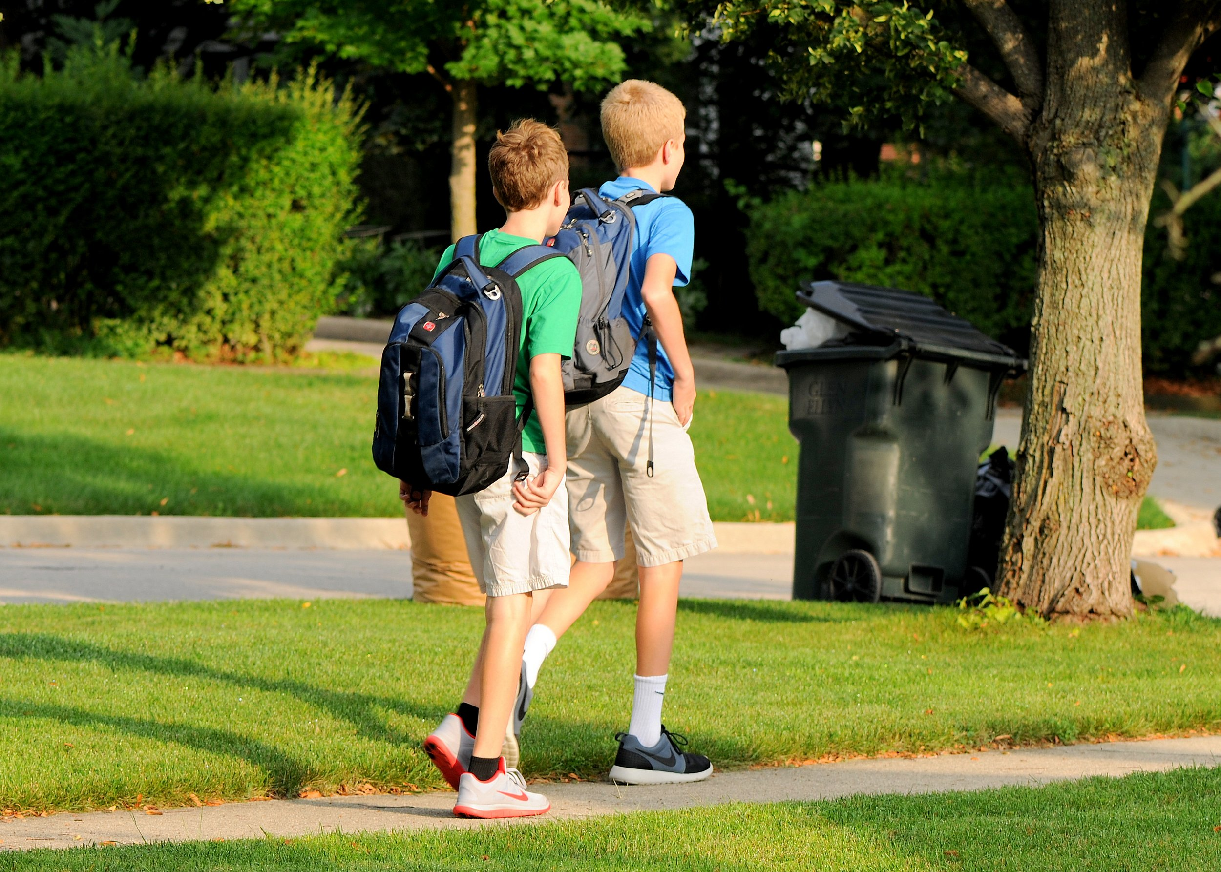 """ Walking to the Bus for the First Day of School - Dryver & Stryde Heading off to Hadley Middle School - 2014 "" by  Jim Larrison  ( CC BY 2.0 )"