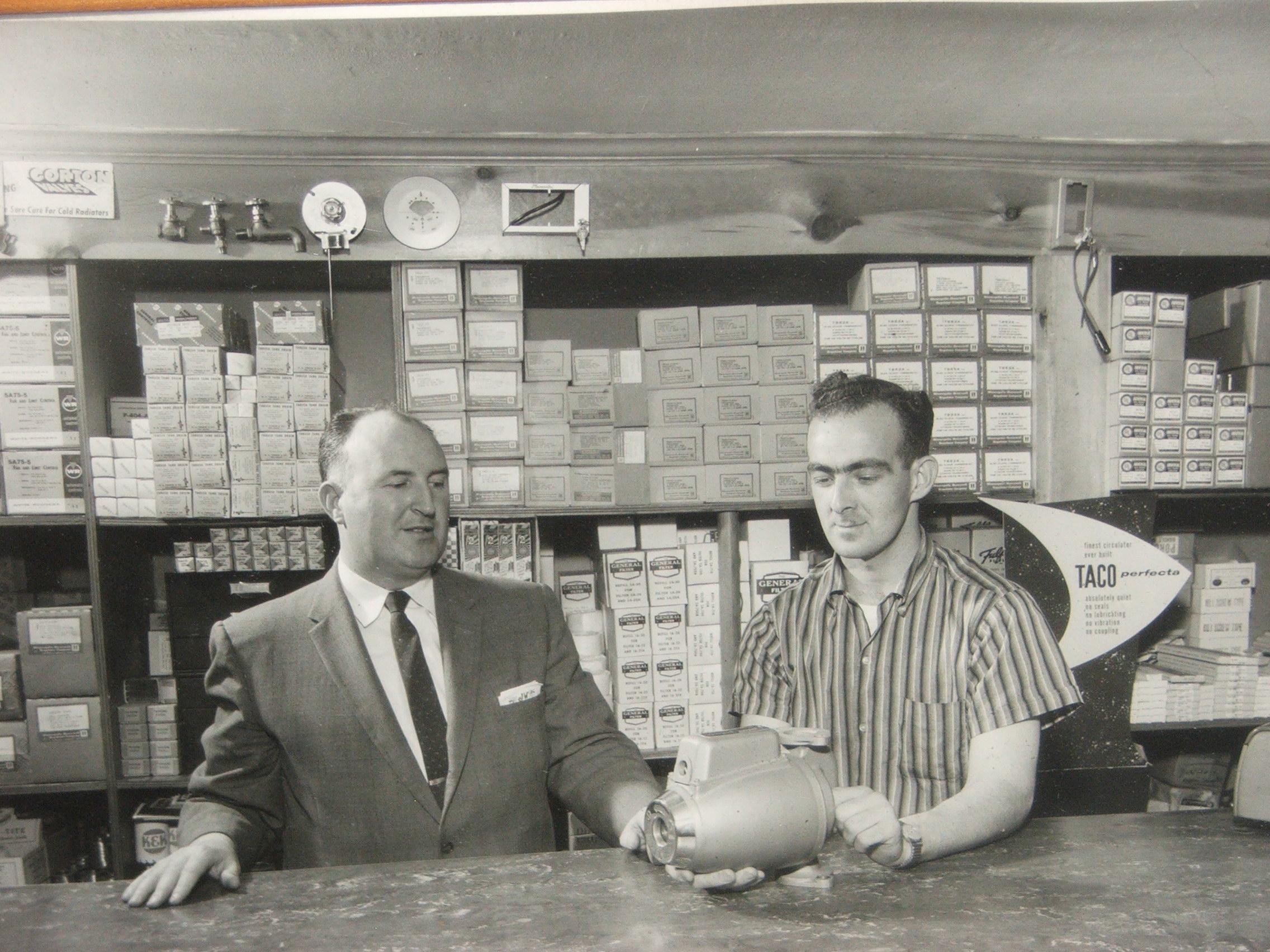 Company founder John F. White (left) and John E. Fogerty holding an early model Taco circulator.