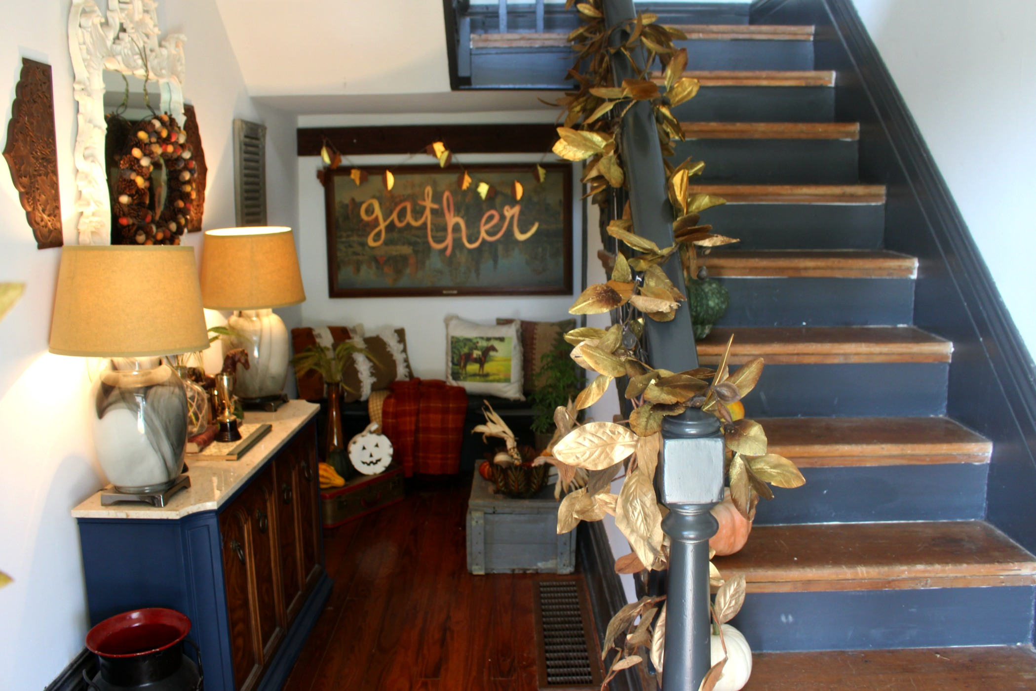 "Gold magnolia garland: thrifted (similar  here )   |    ""Gather"" fall painting: DIY  here    