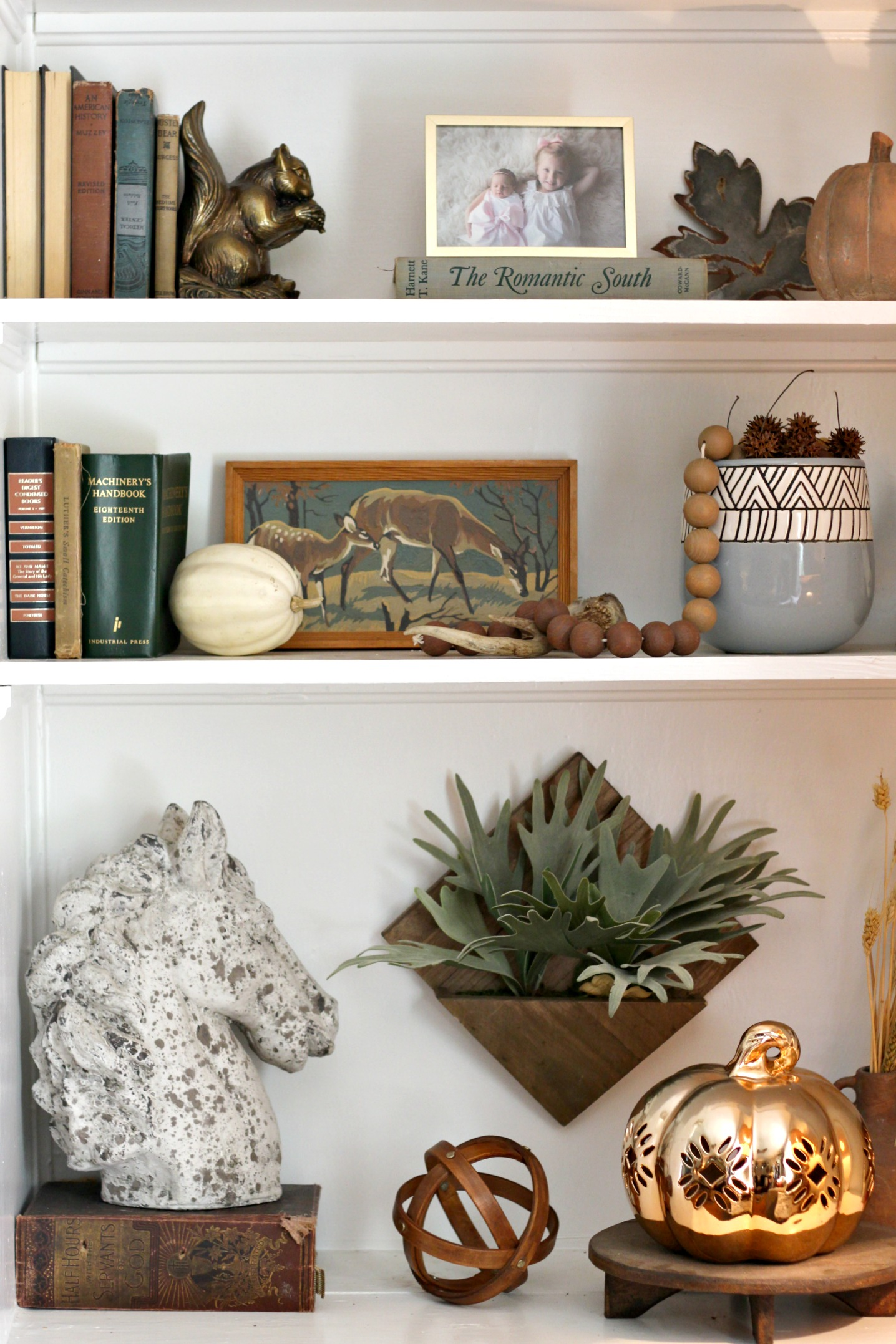 Wood sphere:  At Home  |  Copper pumpkin:  Homegoods  | Horse statue:  Homegoods  | Hanging faux plant:  Target (old)  | Squirrel bookend: vintage|  Old books: vintage/thrifted| Wood beads:  Target   | Blue planter pot:  At Home   |  Deer paint-by-number: thrifted| Metal leaf:  The Findery