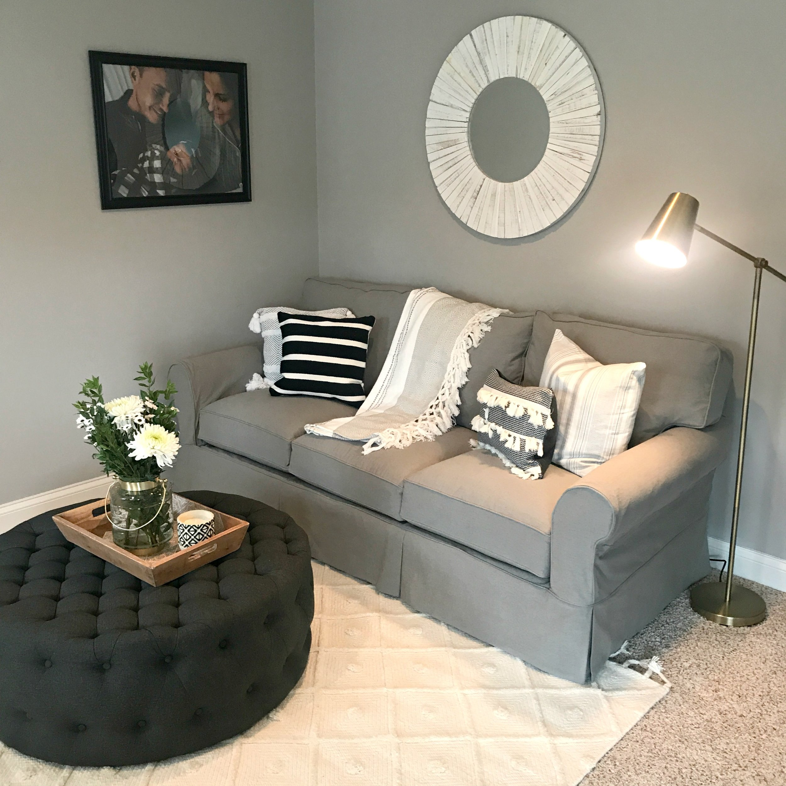 ottoman  |  rug   | couch- Arhaus  | pillows-  At Home ,  Homegoods  +  Target   | throw-  Homegoods  |  lamp  | accessories-  Homegoods   |  mirror