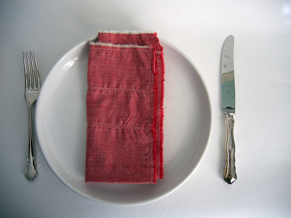 red linen napkins with metallic gold stitching