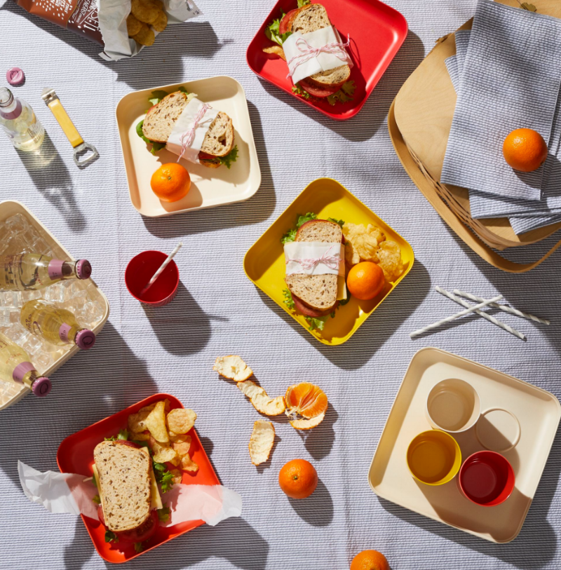 Simple sandwiches and chips.  Food52  using bamboo plates, paper straws, glass bottles and cloth napkins.