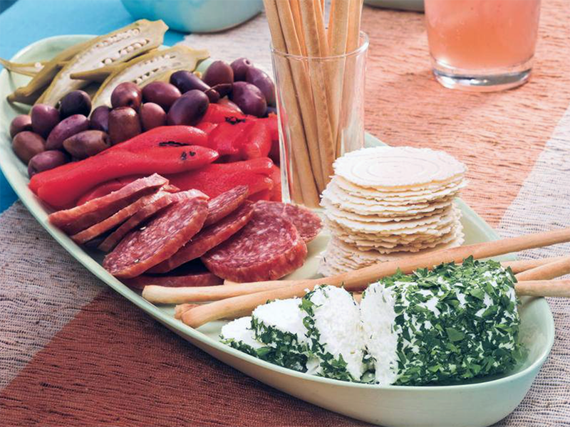 Antipasto platter from Southern Living  - pickled okra, kalamata olives, roasted peppers, salami, breadsticks and cheese.