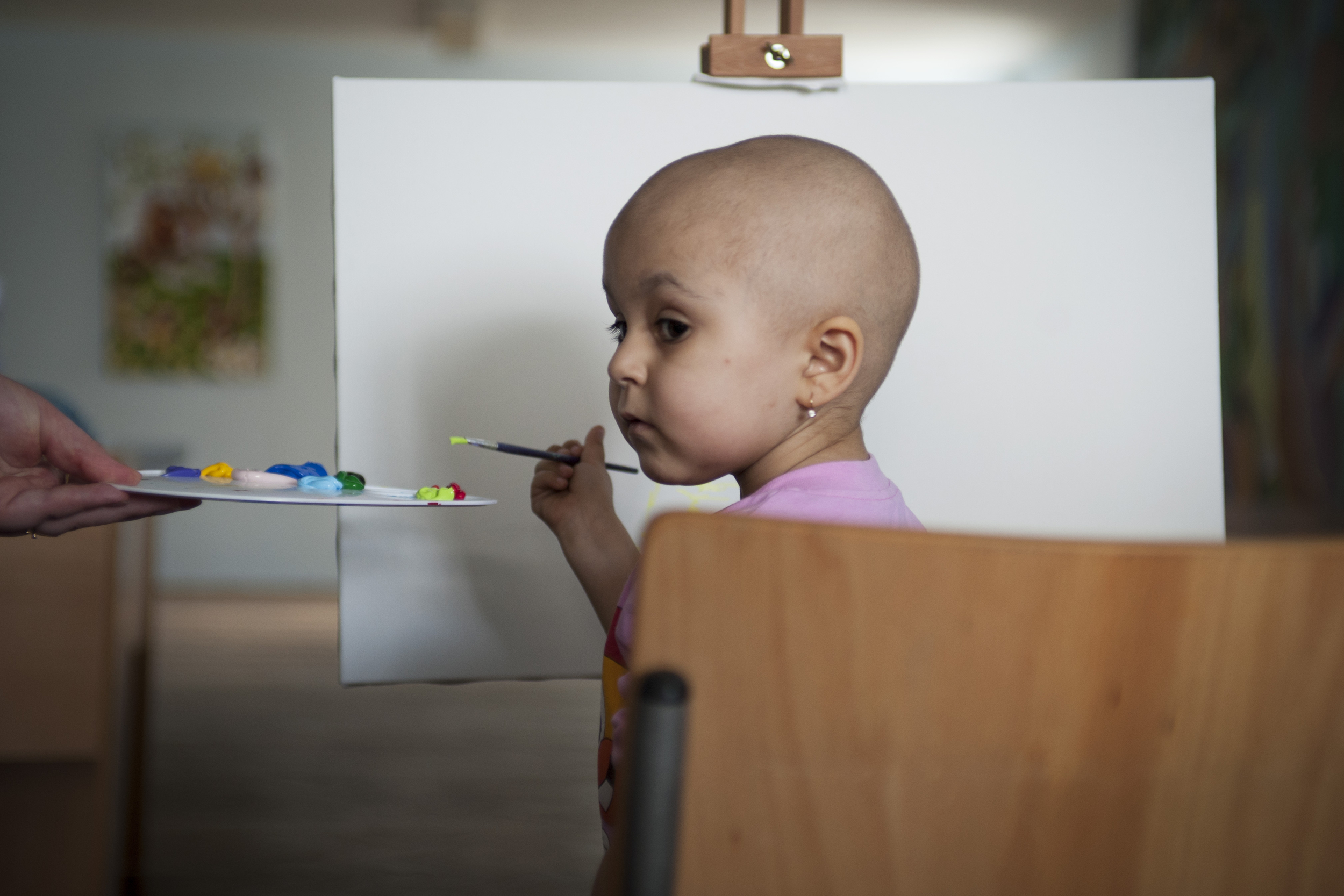 A little girl with blood disease start to draw during the action of support of children. The Children's Chernobyl regional hospital, Lviv, Ukraine.