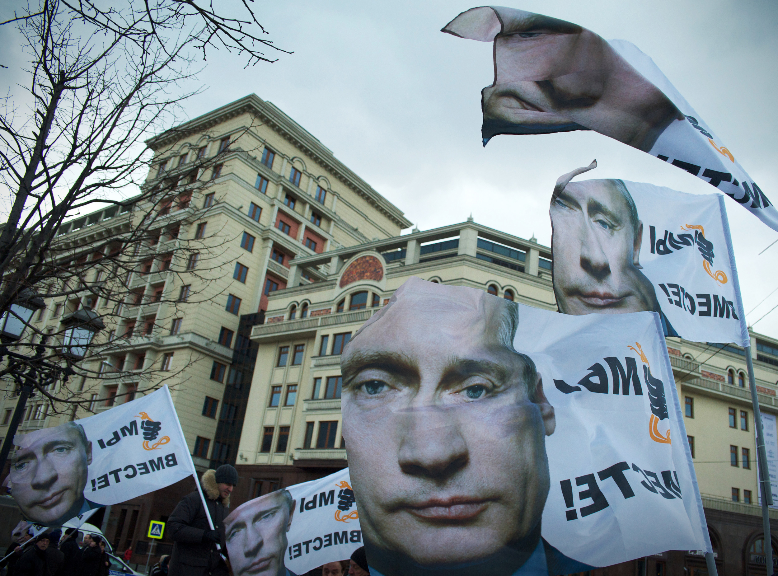 Flags with face of Vladimir Putin.Rally dedicated to accession Crimea to Russia, Moscow.