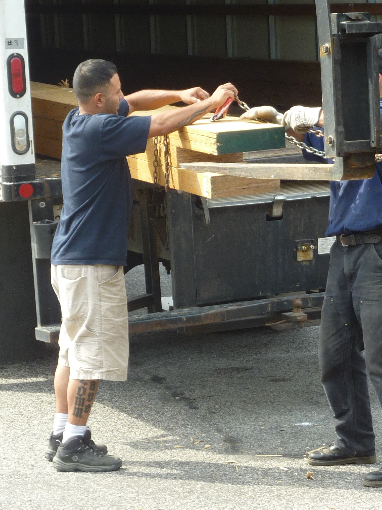 Donations staff member John Robles helps unload.