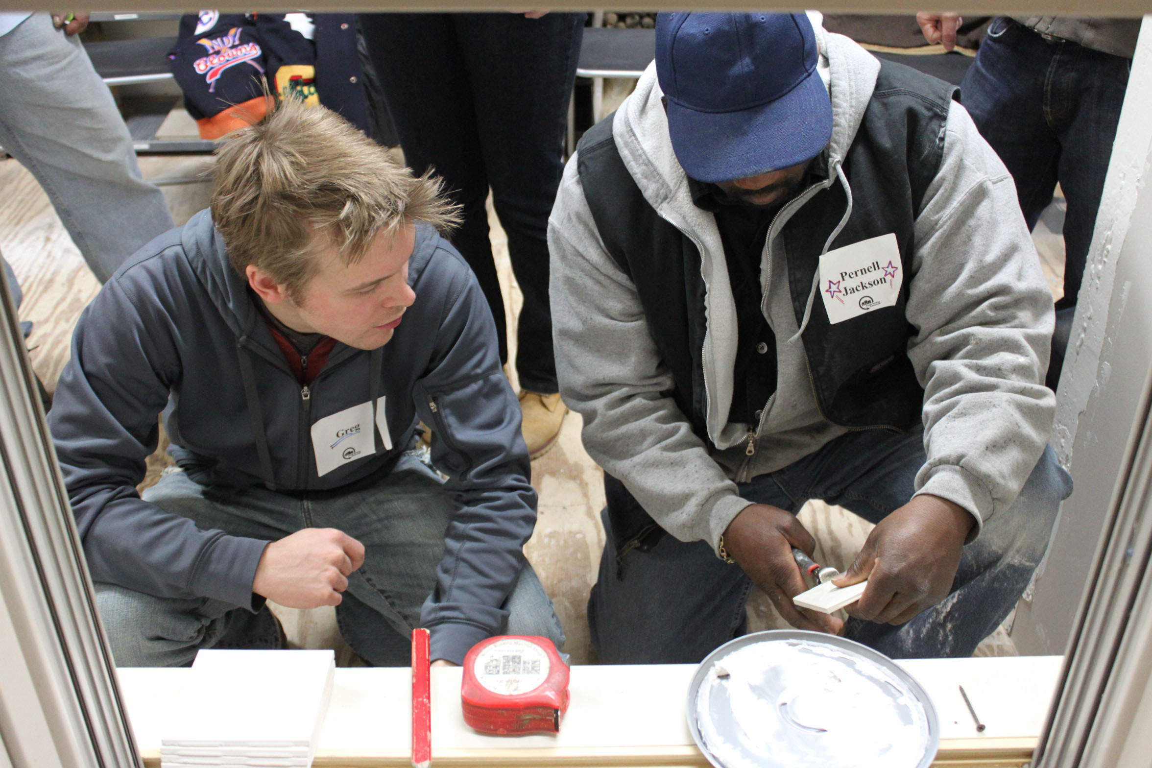 Resident Greg Buckland (left) took BBR's tiling workshop.