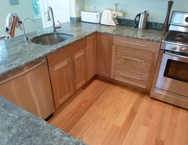 Countertops are granite of an unusual green shade.