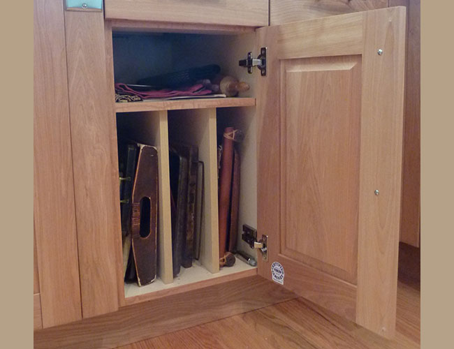 Cabinet dividers keep trays, cutting boards, and other items organized.