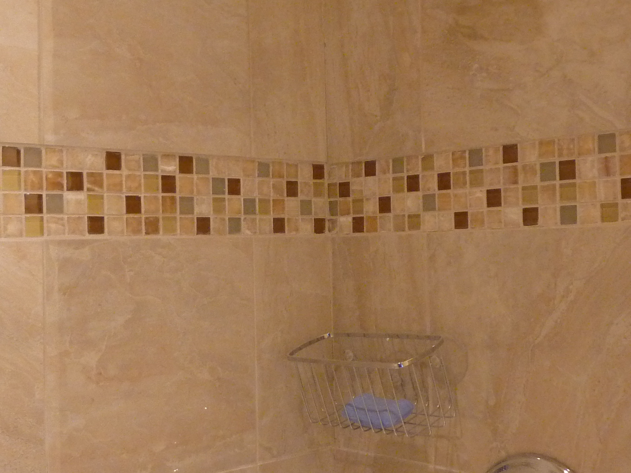 With Reuse Center tile, she created a pattern on the shower wall.
