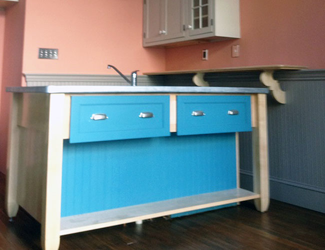 Different paint colors were used on subsets of cabinets.