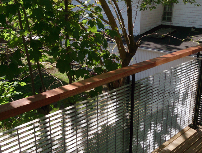 Lee P. made this porch railing out of mahogany from the Reuse Center. He is using lots of tung oil to preserve it.